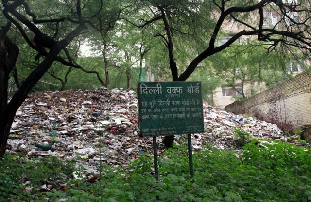 Rampant encroachment and dumping of construction waste are affecting the green cover at Mehrauli Archaeological Park.