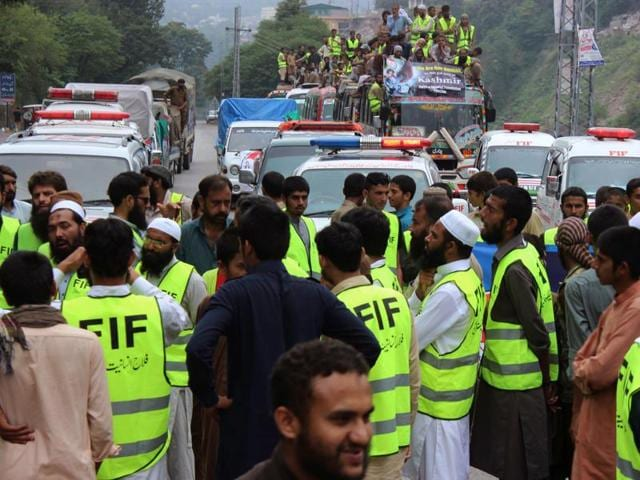 Activists of the Falah-e-Insaniat Foundation gather before travelling to Kashmir with relief material, in Muzaffarabad, Pakistan.