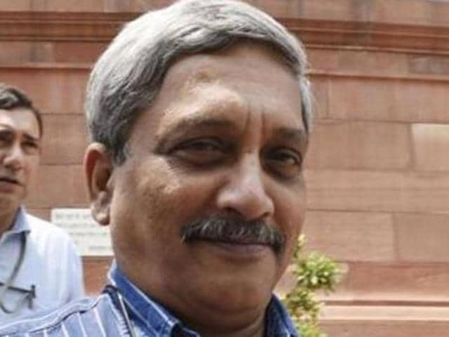 Defence minister Manohar Parrikar interacts with journalists outside Parliament in Delhi.