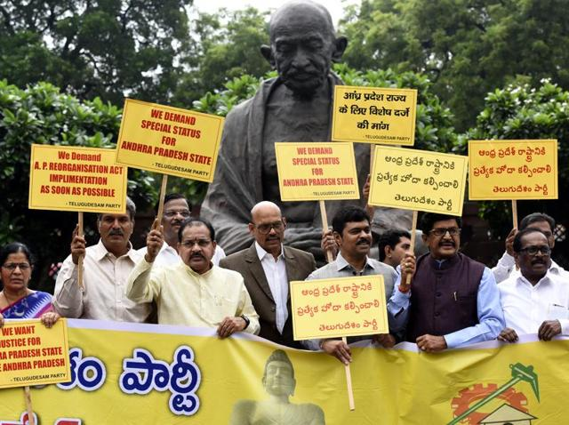 TDP members protest to demand special status for Andhra Pradesh at the Parliament House during the ongoing monsoon session in New Delhi.
