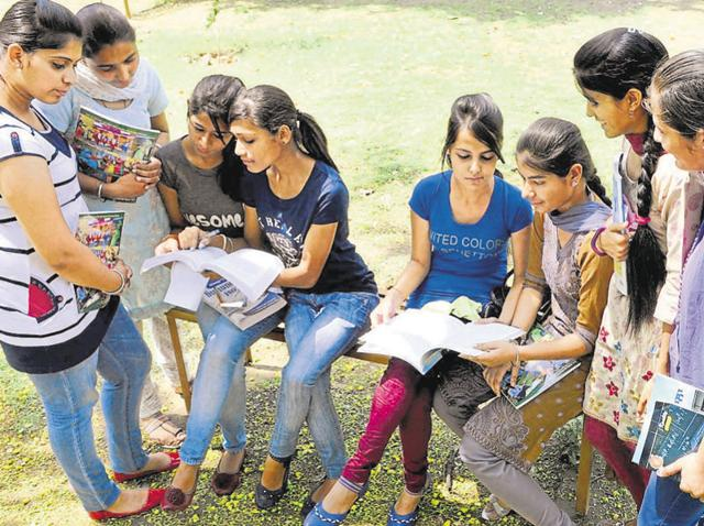 Students filling forms at Government Mohindra College.