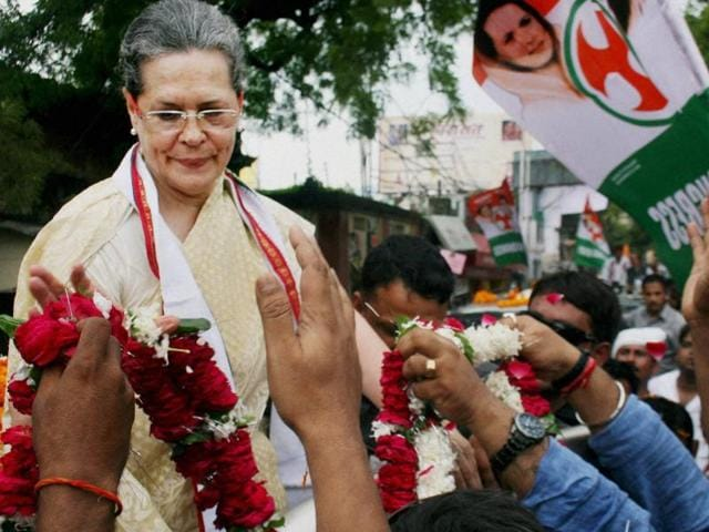 Congress Party President Sonia Gandhi  in Uttar Pradesh's Varanasi during a road show to launch the party's poll campaign in the state on August 2, 2016.