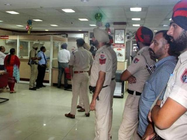 Police at the robbed bank in Ludhiana on Monday.