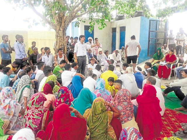 Faridabad district officials interact with Samaipur villagers and educate them about the problems of open defecation.