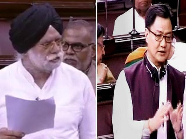 Senior Supreme Court lawyer KTS Tulsi (left) and minister of state for home affairs Kiren Rijiju (right) at Parliament House during the monsoon session.