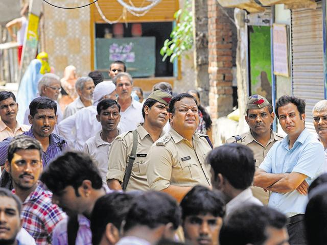 Public near the victim's house. Experts say the family can move court against the people and politicians who are visiting their house.(Sunil Ghosh/HT Photo)