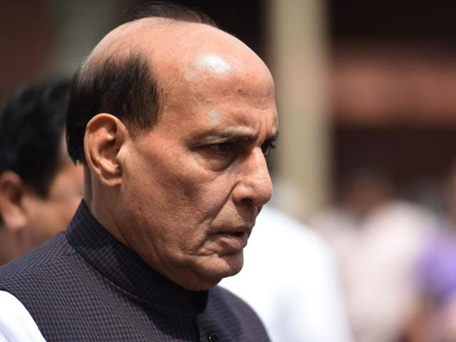 Home minister Rajnath Singh leaves Parliament House, in New Delhi.