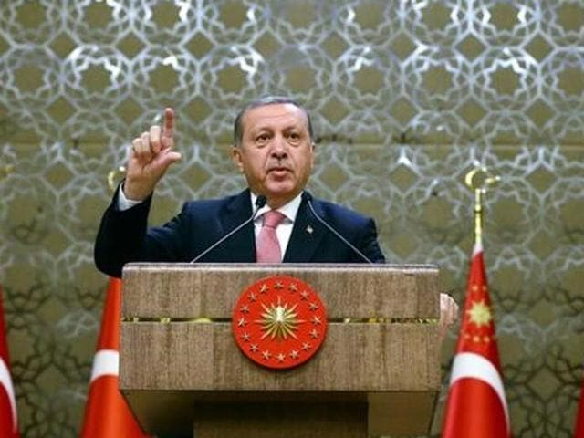 Turkey's President Tayyip Erdogan addresses the audience during a meeting at the Presidential Palace in Ankara, Turkey on Tuesday.