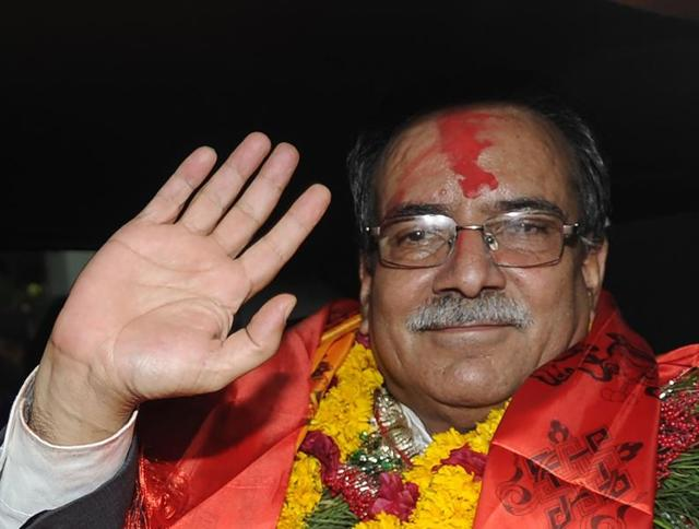 Nepal's newly-elected Prime Minister Pushpa Kamal Dahal, known as Prachanda greets supporters as he leaves the Parliament Building in Kathmandu on Wednesday.