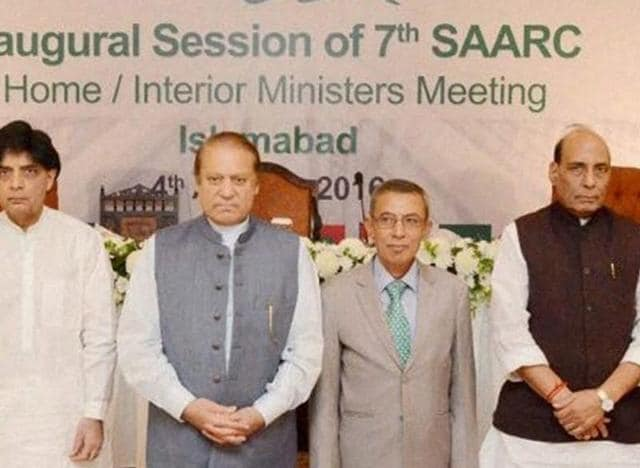 Pakistani official escort Indian Home Minister Rajnath Singh in Islamabad.