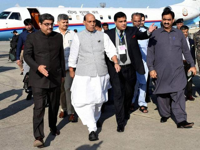 Pakistani officials escort Rajnath Singh, second from left, as he arrives to attend a meeting of the South Asian Association for Regional Cooperation, in Islamabad.