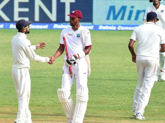 India skipper Virat Kohli shakes hands with West Indies centurion Roston Chase after the rain-hit second Test in Jamaica ended in a draw on Wednesday.