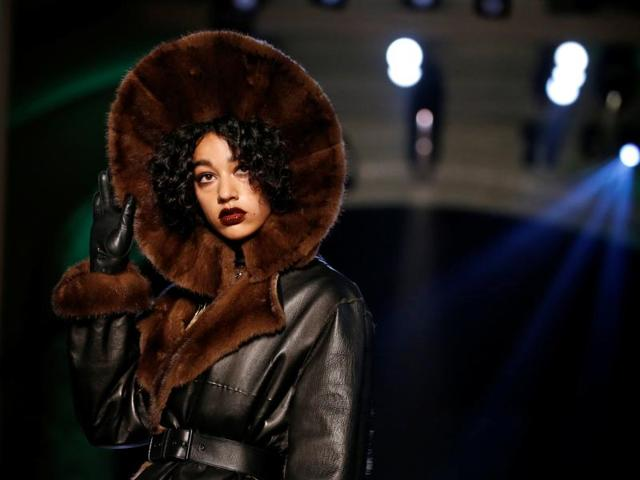 A model presents a creation by French designer Jean Paul Gaultier as part of his Haute Couture Fall/Winter 2016/2017 collection in Paris, France. Luscious wine-dripped lips trended on Gaultier's runway too.