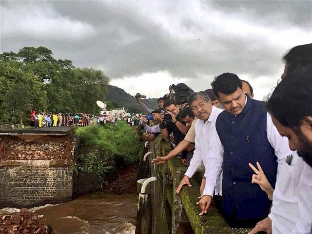 Maharashtra chief minister Devendra Fadnavis visits the Mahad-Poladpur bridge that was washed away by flood waters on Wednesday.