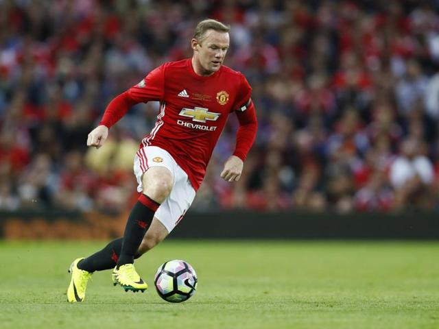 Fans spell out the name of Manchester United's Wayne Rooney ahead of his testimonial match against Everton.