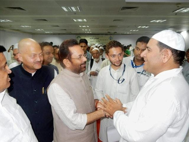 Minister of state for minority affairs (independent charge) Mukhtar Abbas Naqvi with the first batch of Haj pilgrims at Indira Gandhi International Airport in New Delhi on Thursday.
