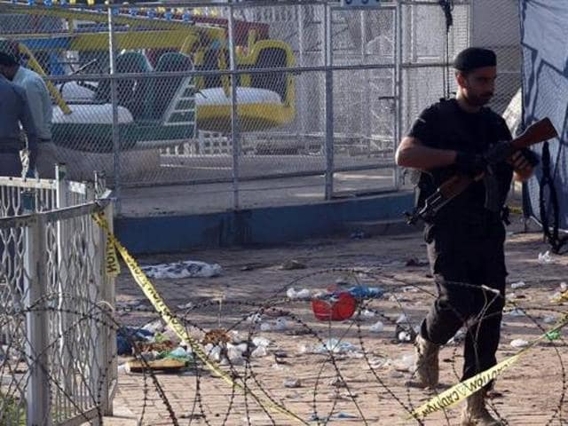 A Pakistani police commando walks at the cordoned-off site of the March 27 suicide bombing, in Lahore. Dubbed the Easter Sunday bombing, the attack left 70 dead, most of who were Christian families celebrating Easter Sunday at a park. Jamaat-ur-Ahrar claimed responsibility for the attack.