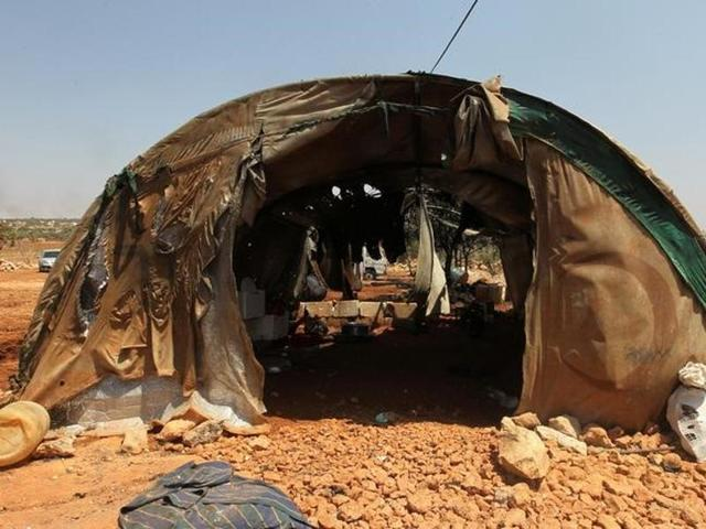 A damaged tent for displaced people is pictured after airstrikes on the outskirts of the rebel-held town of Atareb in Aleppo province.