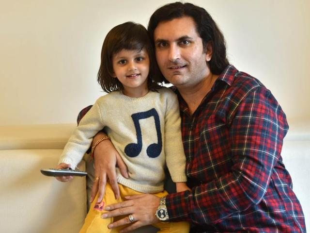 Sharma with his two-year-old son, Abhinav, at their Pali Hill residence