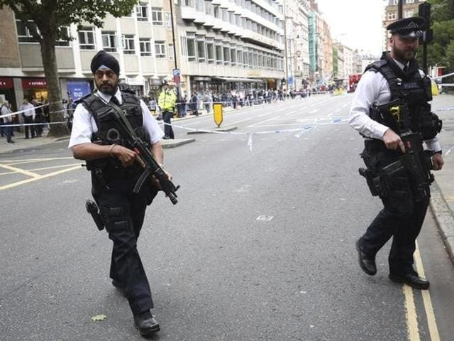 Armed police personnel patrol in London's Trafalgar Square on August 4, 2016, following an overnight knife attack in Russell Square in which one woman was killed and five others injured.