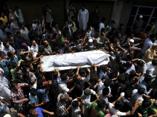 Mourners carry Riyaz Ahmad Shah's body in Srinagar.
