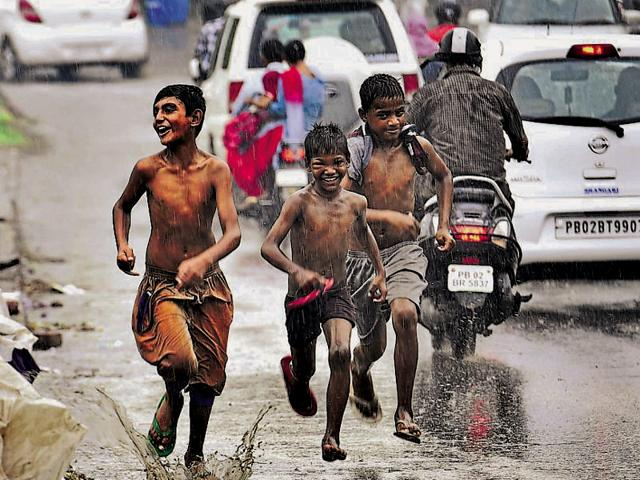 Children making the most of the cool weather in Amritsar on Friday.