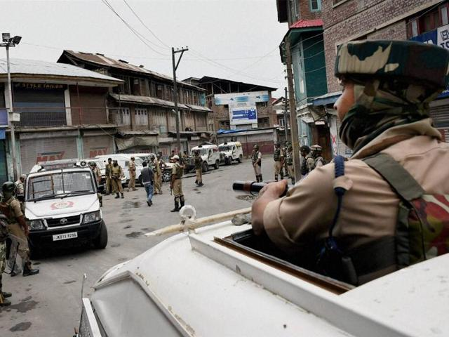 A paramilitary trooper stands guard during curfew in Kashmir. More than 50 people have been killed and thousands injured in weeks of unrest, sparked by the death of militant commander Burhan Wani on July 8.