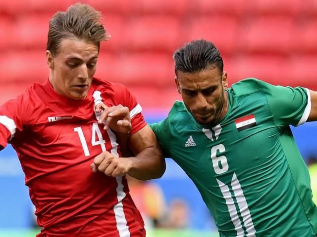 Iraq player Ali Adnan (R) is marked by Denmark player Casper Nielsen during the Rio 2016 Olympic Games.