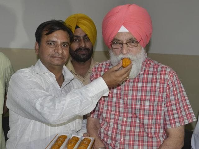 Dr Inderbir Singh Nijjar, AAP's candidate from Amritsar (south) constituency, celebrating after his name was announced for the assembly elections, on Thursday.