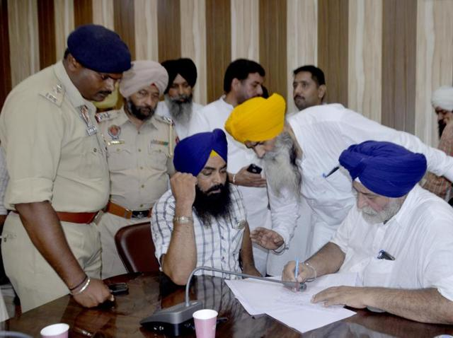 Senior deputy mayor Avtar Singh (right) along with his supporters filing a complaint against SAD youth leader Navdeep Singh Goldy at ADC office conference hall in Amritsar on Thursday.