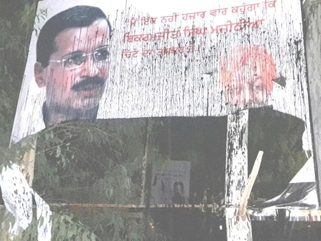 An anti-Majithia poster put up by AAP activists blackened by Youth Akali Dal workers in Hoshiarpur.