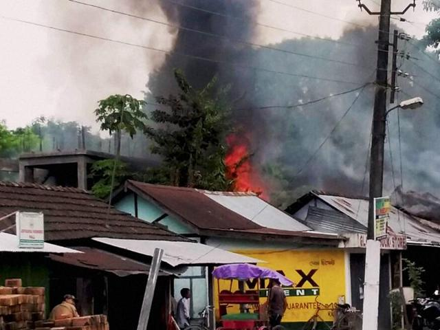 Smoke billowing out of shops after an attack by NDFB-S militants in the market area at Balajan Tinali near Kokrajhar town in Assam on Friday.