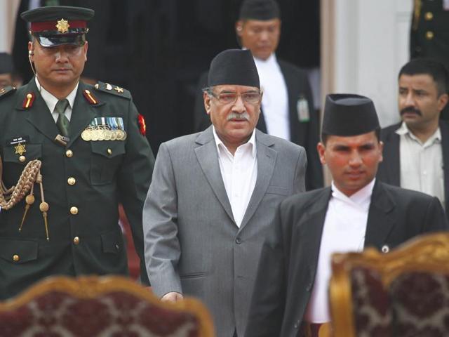 "Nepal's new Prime Minister Pushpa Kamal Dahal ""Prachanda"" administers the oath of office at the presidential building in Kathmandu on Thursday."