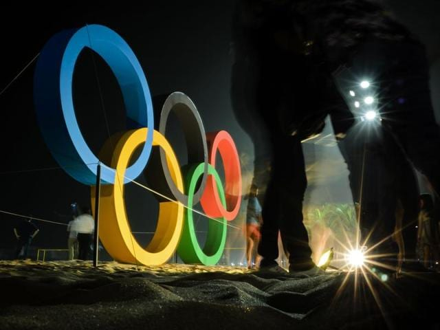 In a statement, police say they arrested boxer Hassan Saada on Friday for possible assaults on two Brazilian women who worked as waitresses in the Olympic village. (AFP Photo)