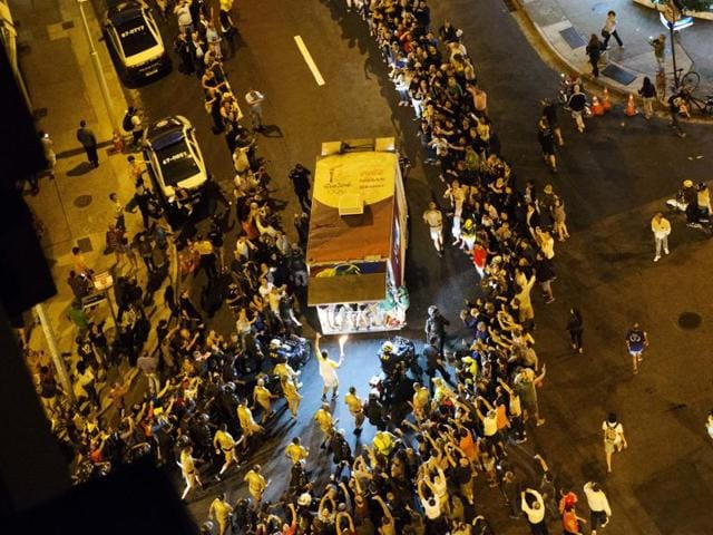 The Olympic torch began its final journey to the opening ceremony of the Games on Friday, while anti-government protests clogged the famous Copacabana beach boulevard. (APPhoto)