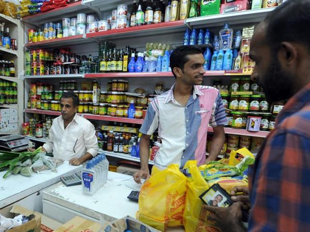 An Indian worker buy groceries at a shop in the Saudi Arabian port city of Jeddah on August 4, 2016. The kingdom has set up a crisis management group to resolve the difficulties faced by thousands of laid-off Indian workers.