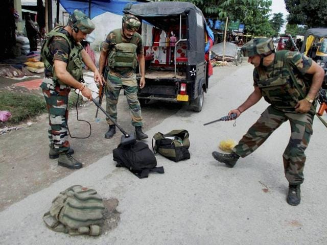 Indian Army scrutinizing the bags with metal detector recovered from the NDFB (S) terrorists who launched open indiscriminate firing in the market area at Balajan Tinali near Kokrajhar town on Friday.