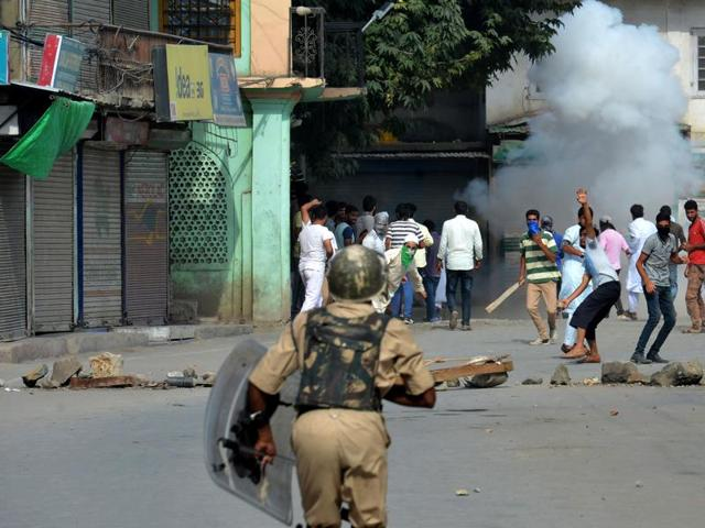 Protestors clash with security forces during a clash in Srinagar.