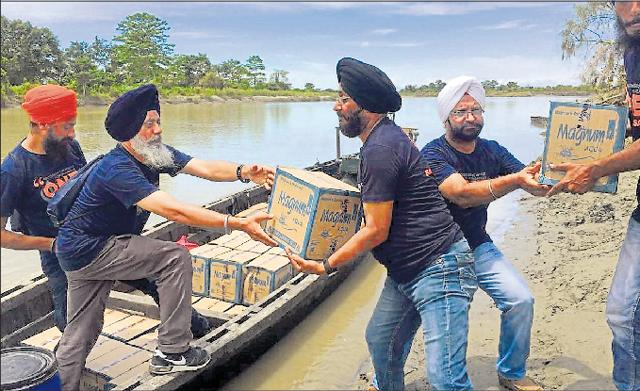Tajinderpal Singh and Harjeet Singh helping with a relief operation in Assam on Friday.