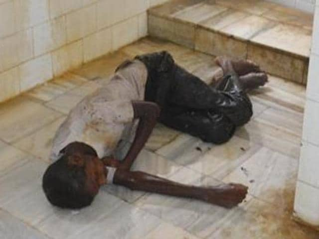The unidentified patient in the toilet of Guru Nanak Dev Hospital, Amritsar, on Friday.
