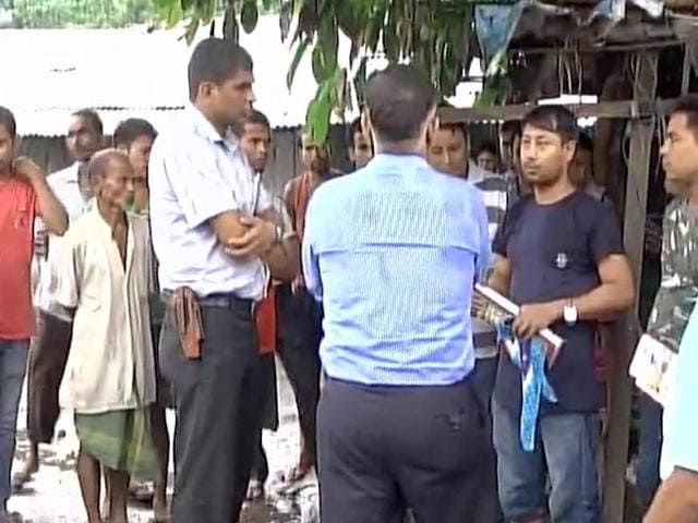 Members of the NIA team interacts with residents of Kokrajhar where an attack by suspected Bodo militants left 14 people dead.
