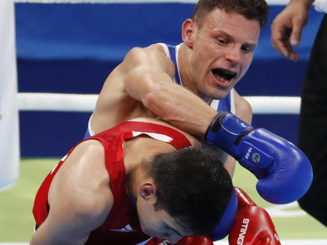 Italy's Carmine Tommasone, right, is one of three professional pugilists to compete in Rio Olympics after the International Boxing Association opened the doors to pros.
