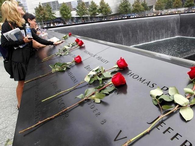 Family members of victims of the 9/11 attacks on the World Trade Center visit the South Pool during ceremonies marking the 10th anniversary in New York, September 11, 2011.