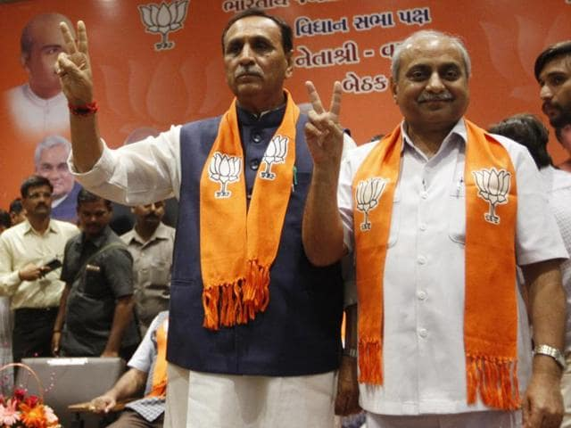 Gujarat chief minister designate Vijay Rupani with his deputy Nitin Patel during a legislative meeting in Gandhinagar.