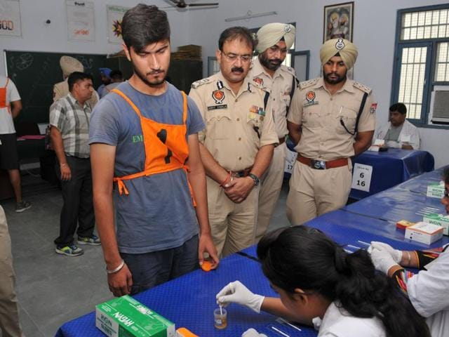 A medical team conducting the dope test of a police job aspirant during the recruitment in Jalandhar on July 27.