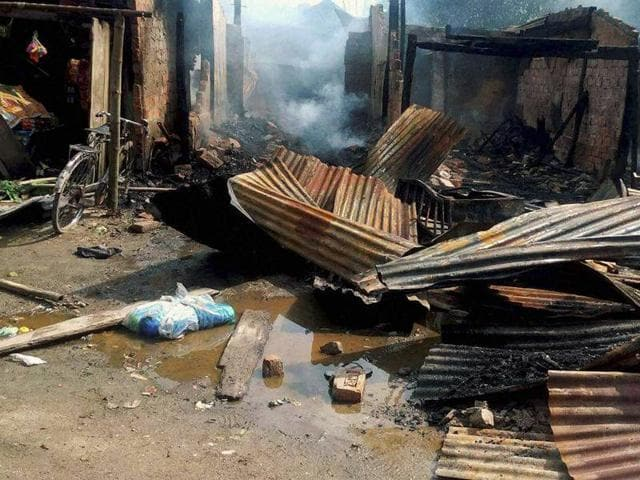 Damaged shops after an attack by suspected  NDFB (S)  militants  in the market area at Balajan Tinali near Kokrajhar town in Assam on Friday, August 5, 2016.