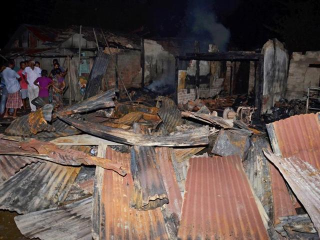Smoke comes out of shops after an attack by NDFB(S) terrorists in the market area at Balajan Tinali near Kokrajhar town in Assam.