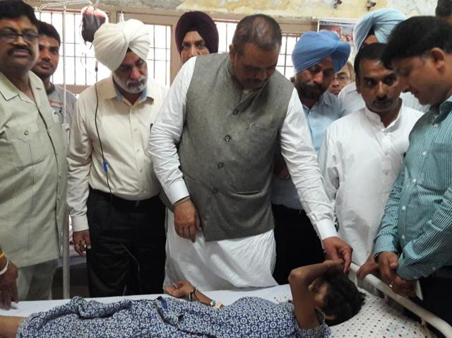 Union minister of state for social justice and empowerment Vijay Sampla interacting with an Sukhjit Ashram inmate at the civil hospital in Jalandhar on Saturday.