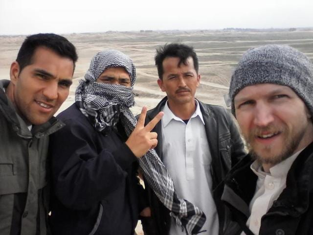 This photograph received from Irish tourist Jonny Blair on August 6, 2016 shows Jonny Blair (right) with three Afghan men during his travels in Afghanistan.(AFP)