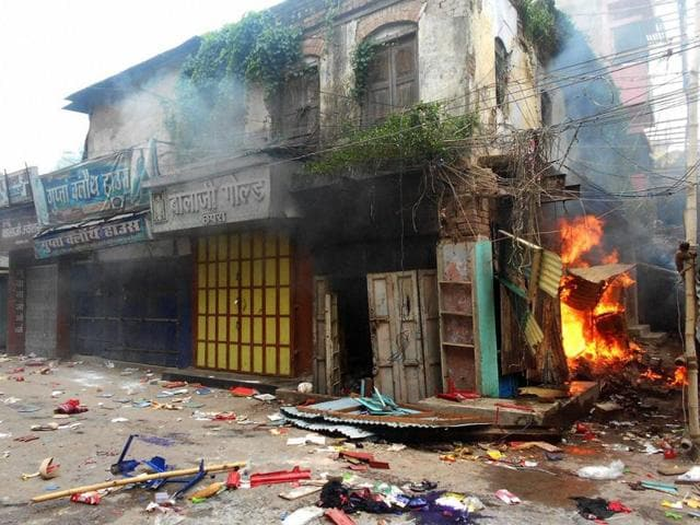 Shops torched by angry protestors after clashes between two communities in Saran district on Saturday.
